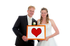 Bridal couple with heart in a frame Royalty Free Stock Photos