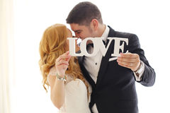 Free Bridal Couple Holding LOVE Letters Royalty Free Stock Image - 88489526