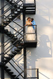 Bridal couple kissing on a  staircase Stock Image