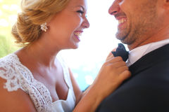 Bridal couple laughing. Closeup of a groom and bride laughing Royalty Free Stock Photo