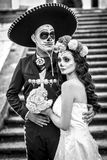 Bridal couple with makeup and costumes typical Mexican in a cementery. royalty free stock photography