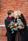 Bridal couple with owl Stock Images