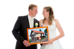 Bridal couple with a photo of her new home Royalty Free Stock Photo