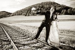 Bridal couple on rails, toned Stock Photography