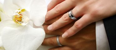 Bridal couple's hands stock image
