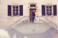 Bridal couple on stairs of their house Stock Photos