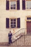 Bridal couple on stairs of their house Stock Image