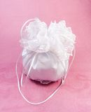 Bridal Dorothy Bag. Wedding purse in silk and satin in white Royalty Free Stock Photos