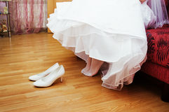Bridal dress and shoes Royalty Free Stock Photo