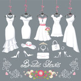 Bridal dresses hang on ribbons.Fashion accessories. Wedding dresses hanging.Fashion bride short Dress made in flat style.White dress,accessories set,flowers Royalty Free Stock Photos