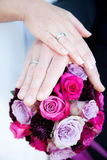 Bridal flowers. Beautiful bridal flowers with the Hands of the couple Stock Photo