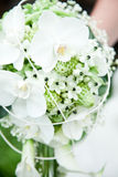 Bridal flowers. Beautiful bridal flowers in a womens hand Royalty Free Stock Photography