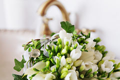 Bridal flowers. Bridal bunch of flowers watering in sink closeup photo Royalty Free Stock Photography