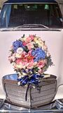 Bridal flowers. Decorated on the bonnet of wedding car Stock Images