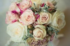 Bridal Flowers muted. A cloesup of Bridal flowers , in muted soft colour tones on a bed stock images