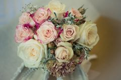 Bridal Flowers muted. A cloesup of Bridal flowers , in muted soft colour tones on a bed stock photos