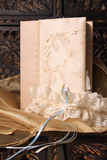 Bridal Garter. Cream Colored Jewellery box and bridal garter Royalty Free Stock Photo