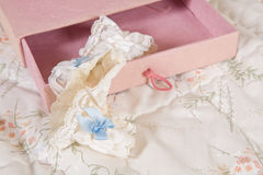 Bridal garter in pink box Royalty Free Stock Photo