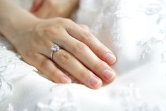 Bridal gown and engagement ring