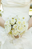 Bridal gown and flowers. Royalty Free Stock Photos
