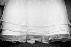 Bridal Gown with Shoes. Bridal wedding gown with shoes peaking out from underneath Royalty Free Stock Image