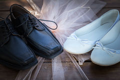 Bridal and groom shoes. On desk Stock Images