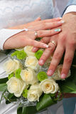 Bridal Groom Wedding Hands on Bouquet Royalty Free Stock Photo