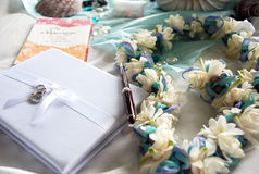Bridal guest book, lei and wedding objects Stock Images