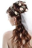 Bridal hairstyle. Fashion bridal hairstyle with floral decoration Stock Photos