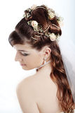 Bridal hairstyle. Fashion bridal hairstyle with floral decoration Stock Photography