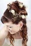 Bridal hairstyle. Fashion bridal hairstyle with floral decoration Stock Photo
