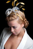 Bridal hairstyle. Fashion model with bridal hairstyle, isolated on black Stock Images