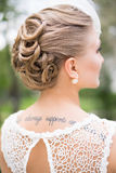 Bridal hairstyle, blonde hairs. And tatoo Royalty Free Stock Photo