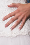Bridal Hand. Hand of a bride on her wedding gown Royalty Free Stock Images