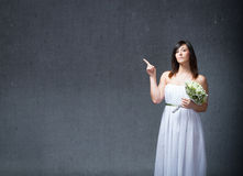 Bridal indicated with finger. People emotions and expressions in dark background royalty free stock photography