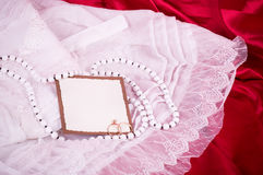 Bridal lace and wedding rings Stock Image