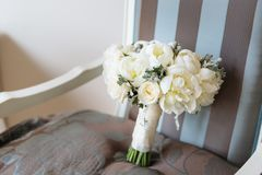 Wedding rustic bouquet on vintage striped chair. Bridal room interior. Bridal morning concept in pastel colors stock photos
