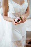 Bridal morning preparation for the ceremony. tender white blossom in her hands. At home Royalty Free Stock Image