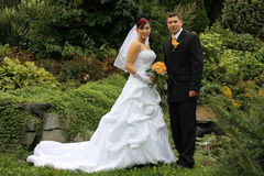 Bridal pair. Bride and groom in the park Royalty Free Stock Images