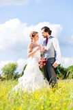 Bridal pair celebrate wedding day with champagne Stock Photography