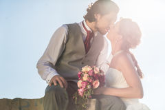 Bridal pair kissing after wedding Royalty Free Stock Images