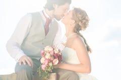 Bridal pair kissing after wedding Royalty Free Stock Photo