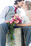 Bridal pair kissing after wedding Royalty Free Stock Photo
