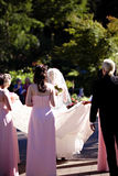 Bridal party. Wedding bridal party carrying brides train Stock Images