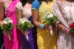 Bridal Party. Bride and Bridesmaids in colorful Saris before the wedding Stock Images