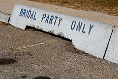 Bridal party only concrete jersey barriers in front of a hall Royalty Free Stock Photo