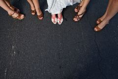Bride and Bridal Party woman show off their shoes royalty free stock photo