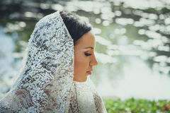 Bridal portrait of beautiful blue eyes woman with lace veil outd. Oor shot Stock Images