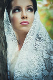 Bridal portrait of beautiful blue eyes woman with lace veil outd. Oor shot Stock Photography