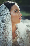 Bridal portrait of beautiful blue eyes woman with lace veil outd. Oor shot Royalty Free Stock Photos
